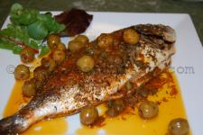 Baked bream with olives and capers