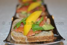 Exotic bruschetta with salmon fumé, avocado and mango
