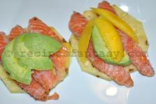 Pineapple Canapé with salmon fume, mango and avocado