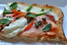 Pizza with salmon fume, capers and cauliflower bed